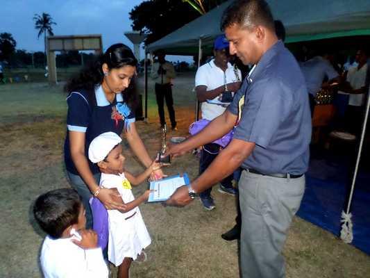 A small Girl Receiving an Award