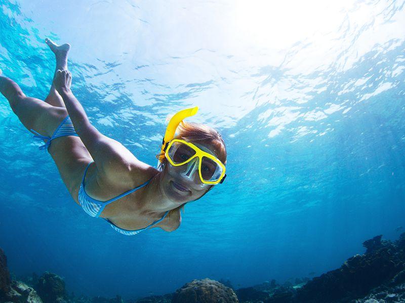 Girl Snorkeling in the Deep Sea