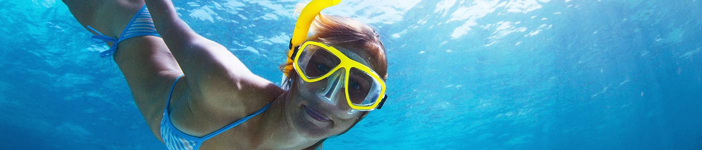 Girl Snorkelling in the Deep Sea